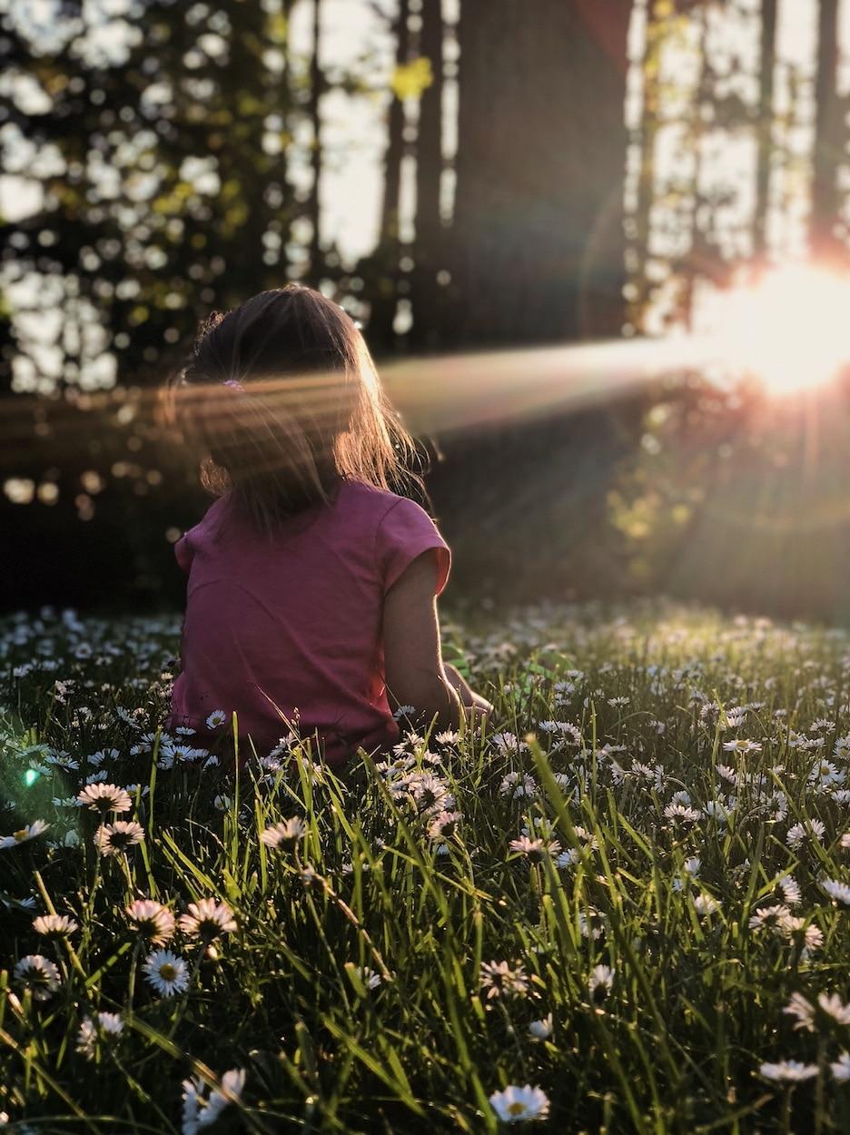 child outside in sunbeam