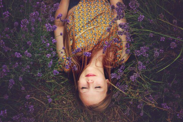 girl lying in flowers