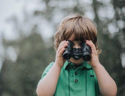 boy binoculars outside