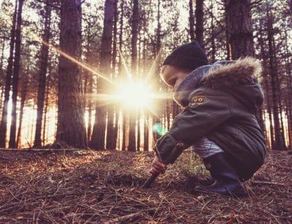 child in sunbeam outside