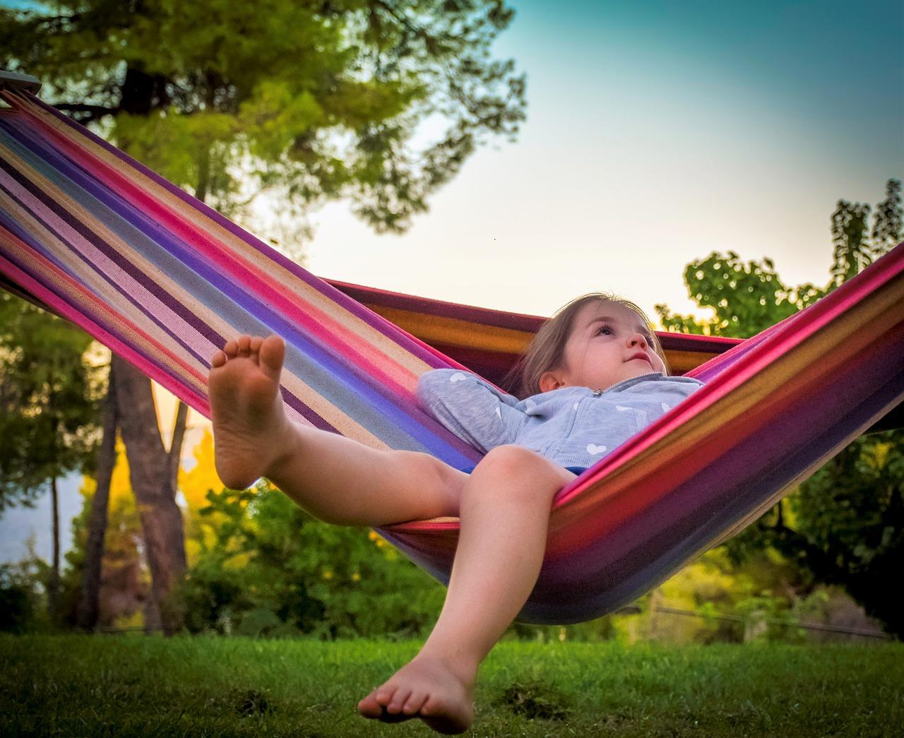 child in hammock outside