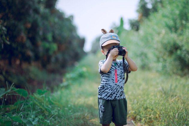 little boy taking video