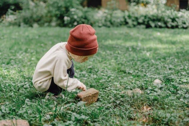 child exploring nature